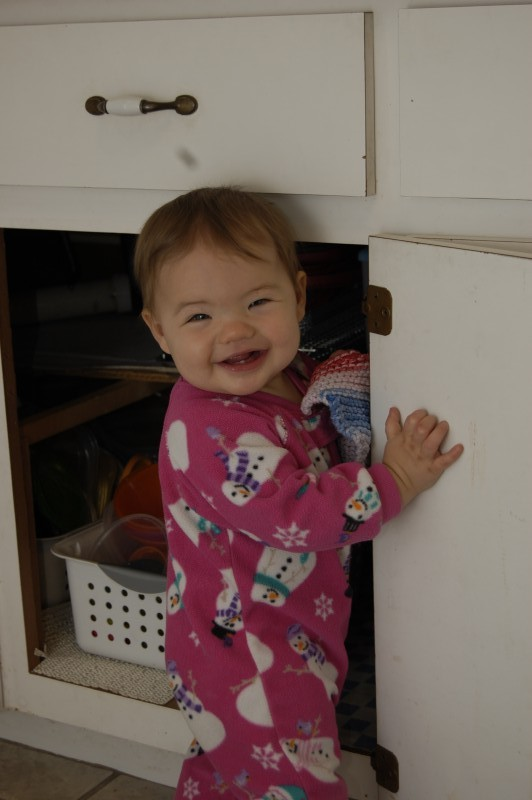 It's so much fun to play in the kitchen cabinets :)
