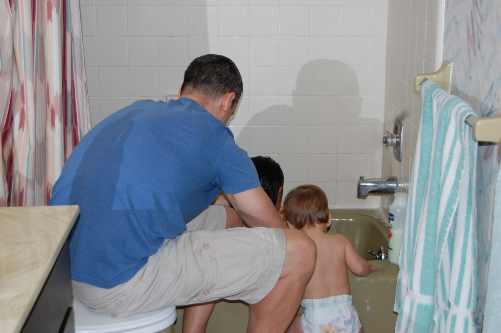 Helping Daddy give Lucy a bath :)