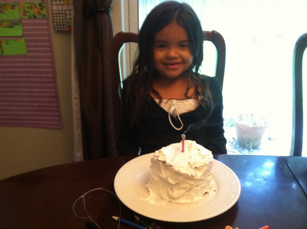 Her party cake had ice cream in the middle, so I used the round piece of cake from the cut out for a mini-cake.
