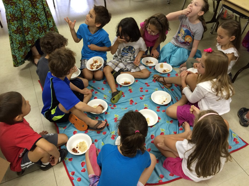 The children learned about the country of Uganda and got to experience eating a traditional dish of beans and rice with only hands and no utensils.  Some took to this more than others.  It was not really Tyler's cup of tea ;