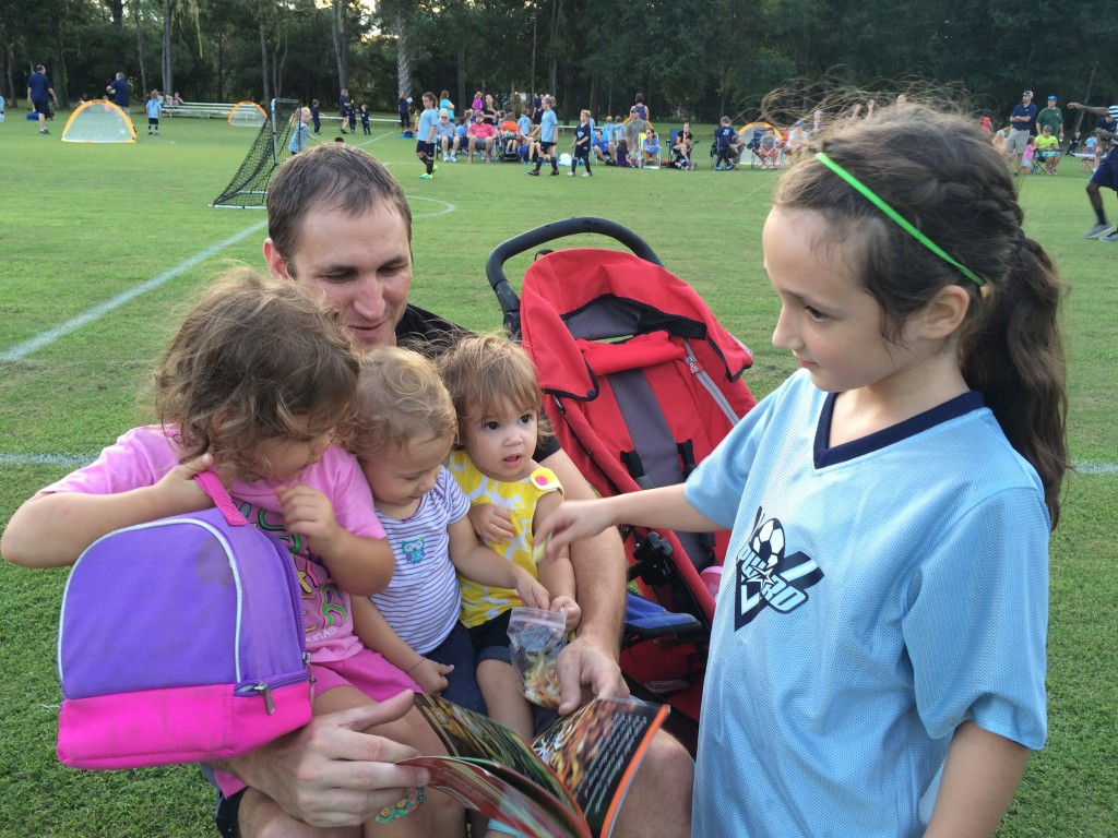 Mr. Jeremiah Carlson holding his daughter Violet, niece Mia, and our Emma with Lydia in foreground.